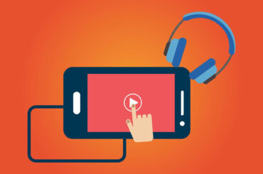 Telefon z ręką i słuchawkami